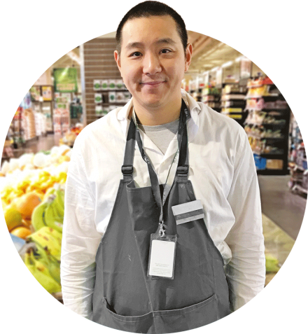 Man with developmental disability working at supermarket